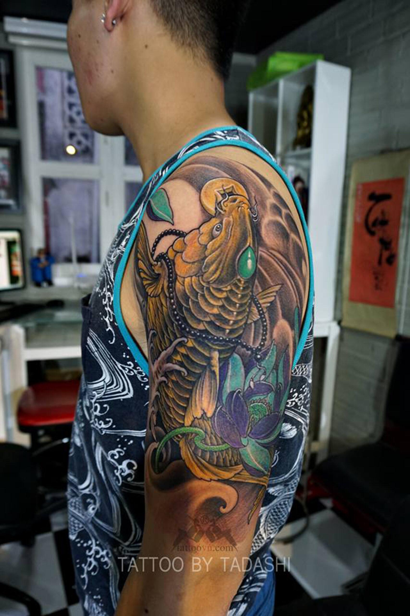 tattoo cá chép ngậm đồng tiền