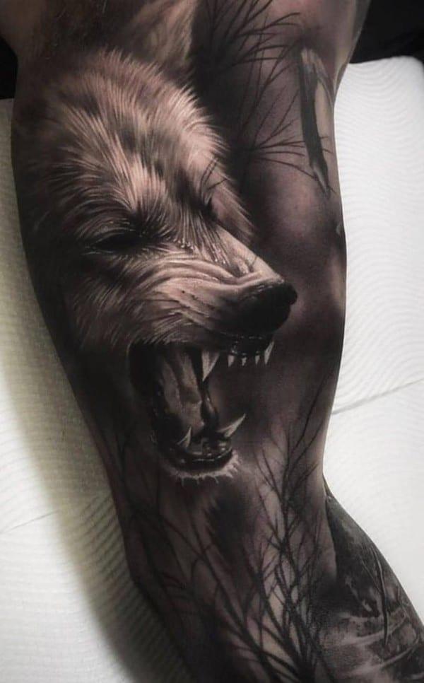 hình xăm chó sói bít tay