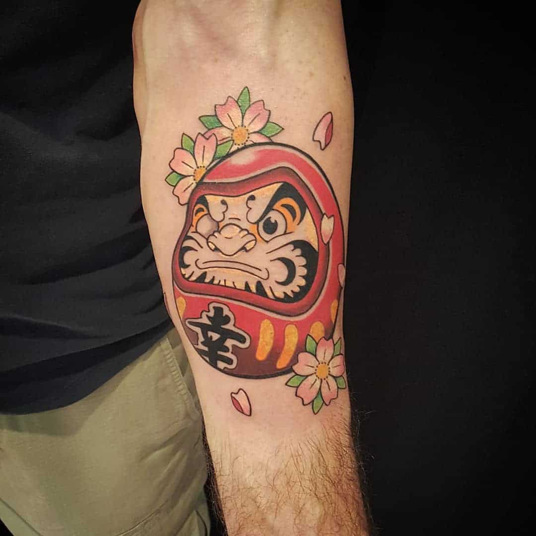 mini daruma tattoo