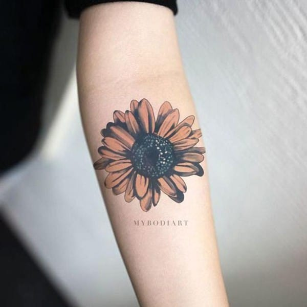Small-sunflower-tattoo-for-women