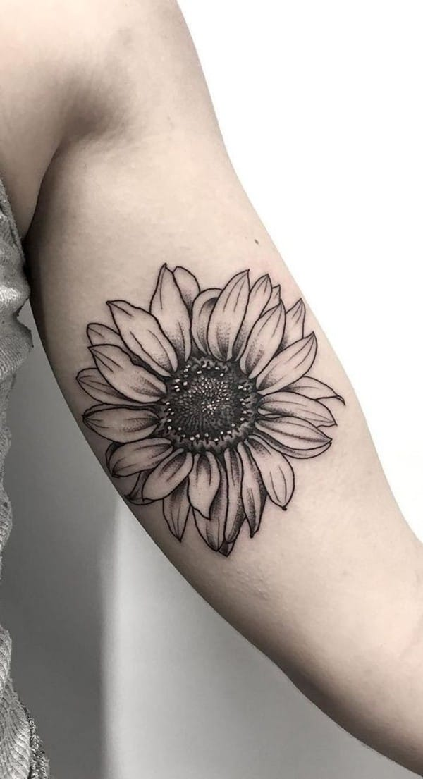 Sunflower tattoo in hand