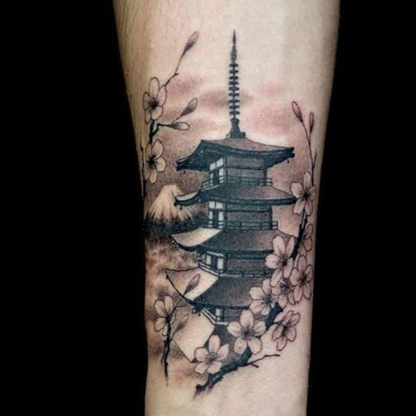 tattoo tòa tháp và hoa anh đào