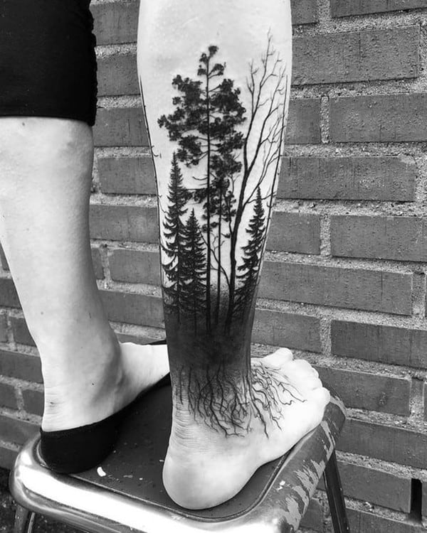 forest tattoo in leg