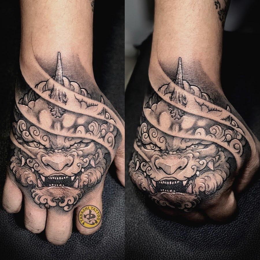 hình xăm kỳ lân trên bàn tay
