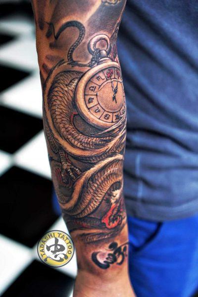 hình xăm rồng ở cánh tay cực chất cho người sinh năm 1980