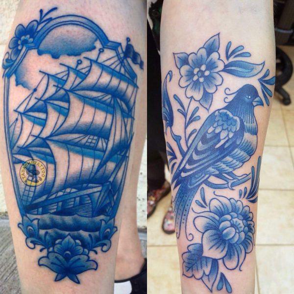 hình xăm chiếc thuyền buồm và con chim màu xanh dương đẹp hợp mệnh với những người sinh năm 1981