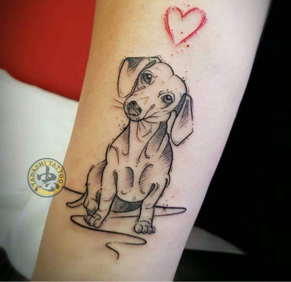hình xăm chó ở cánh tay đơn giản bắt mắt cho các bạn nữ sinh năm 1982
