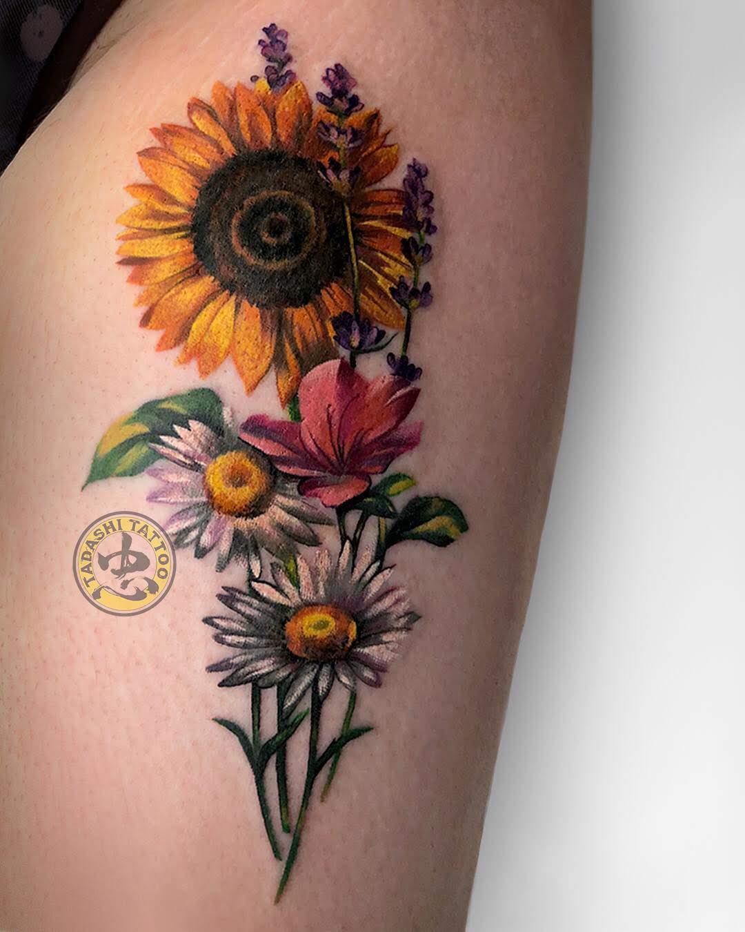 Hình xăm hoa hướng dương chính là một trong những hình xăm hợp tuổi 1987 nhất nếu xét theo tính cách của họ