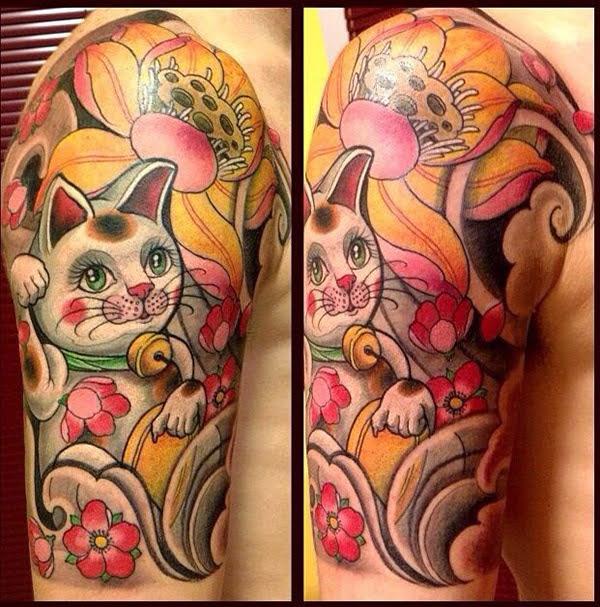 hình xăm mèo thần tài ở bụng